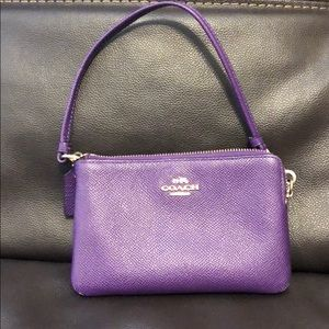 Purple Coach wristlet